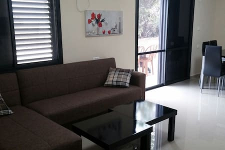 +Breakfast ingridients. 2 bed rooms and living room that is also bed room +bathroom and shower+kitchen with oven,gass,big fridge,microwave , dining room. big bbq terace in  garden with dinning table. free parking , 15 minutes drive from sea of galile