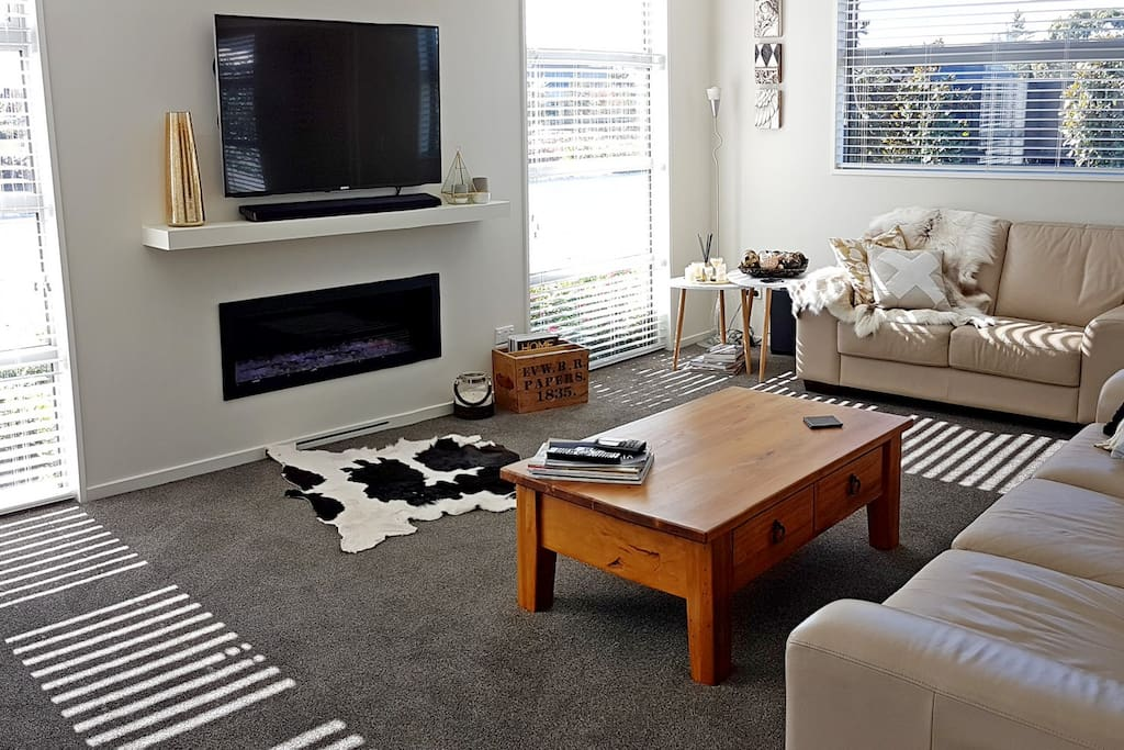 The front living and media room with a cosy gas fire perfect for winter months