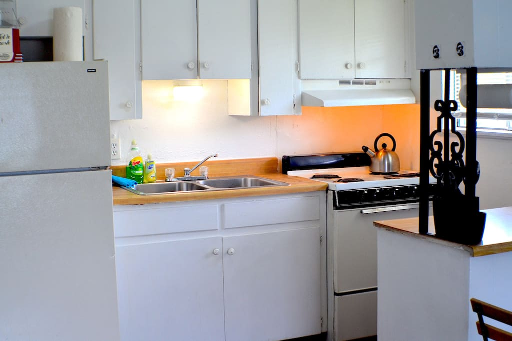 Kitchen with fridge, stove, oven, microwave, coffee maker and coffee provided!