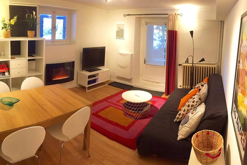 Living Room with dining area and electric fire. TV with Netflix.