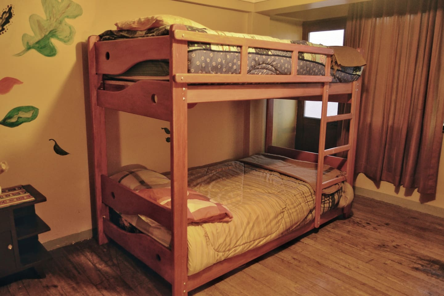 Two of the four beds in this shared bedroom