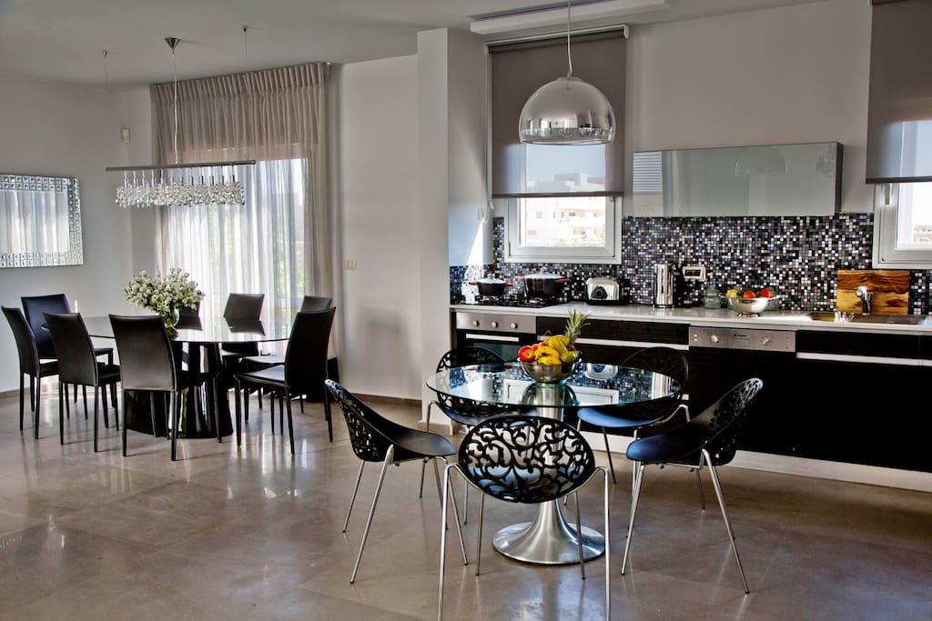Fully equipped kitchen, flat screen TVs, professional grill and more.