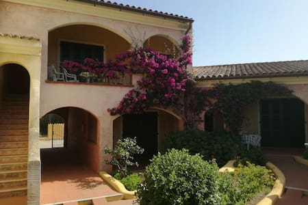 Charming House by the sea in Porto Pozzo