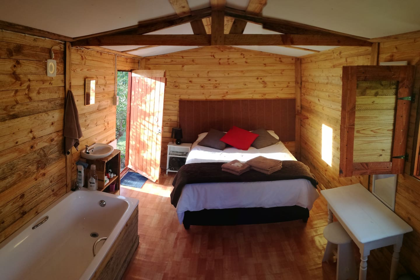 Bedroom with double bed, electric blanket, basin and bath, kettle