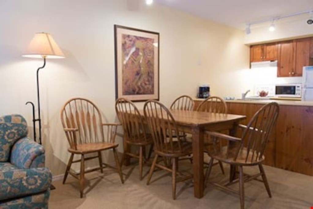 Enjoy meals together at the wooden dining table.