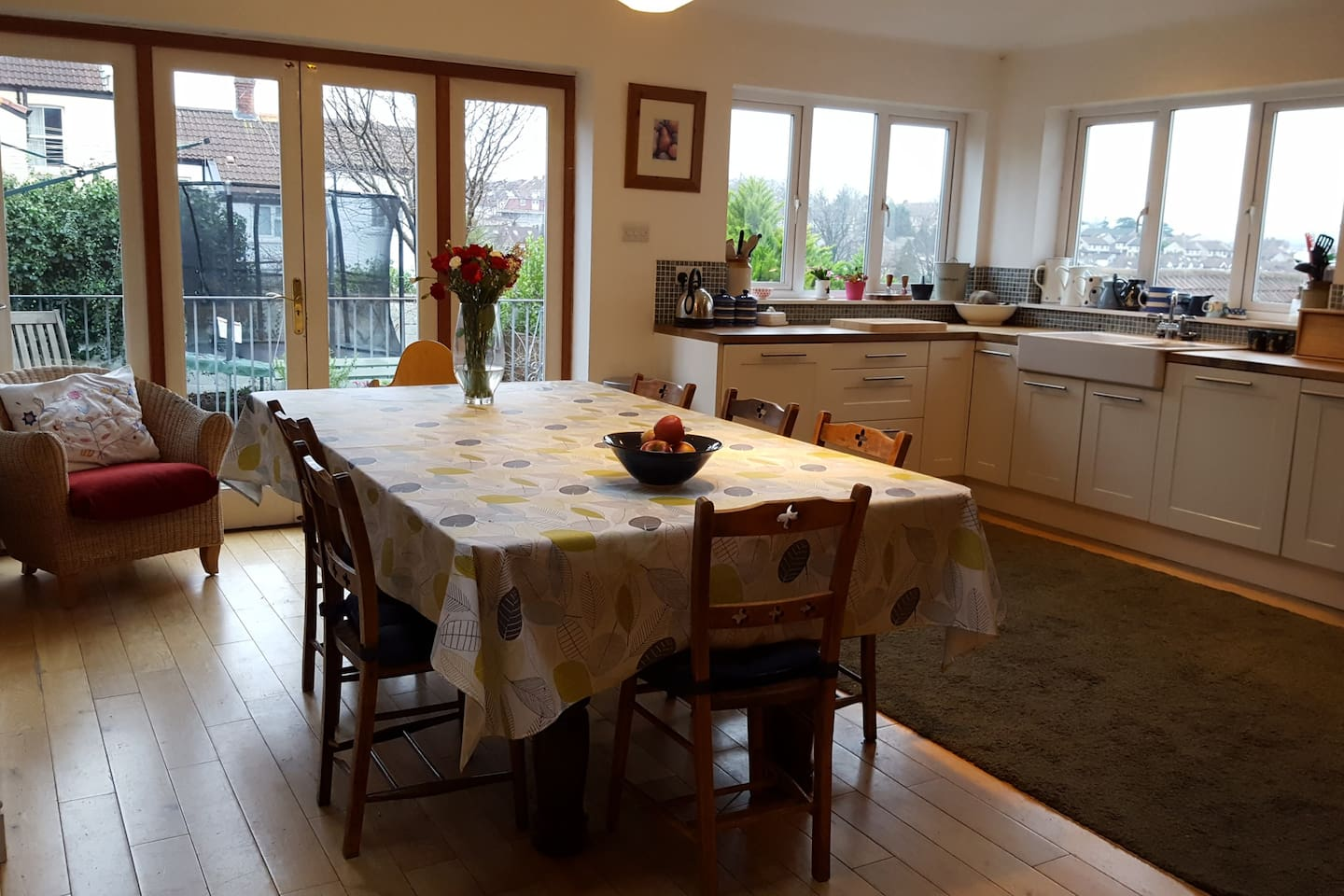 Large kitchen diner opening onto a deck with views over Bristol