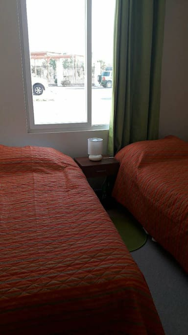 Dormitorio secundario con 2 camas