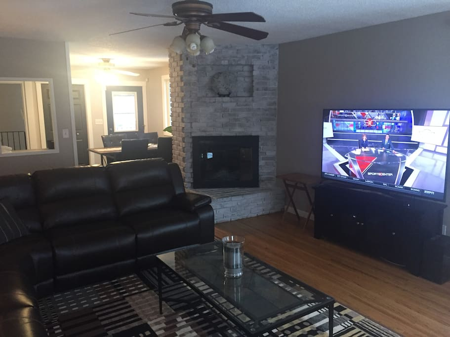 "Living room boasts a 65"" TV"