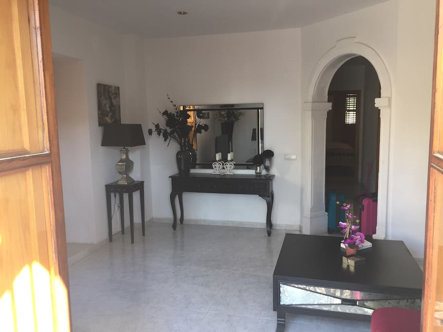Spacious lounge. Light and airy with comfortable sofa and coffee table. There is a TV and DVD player.