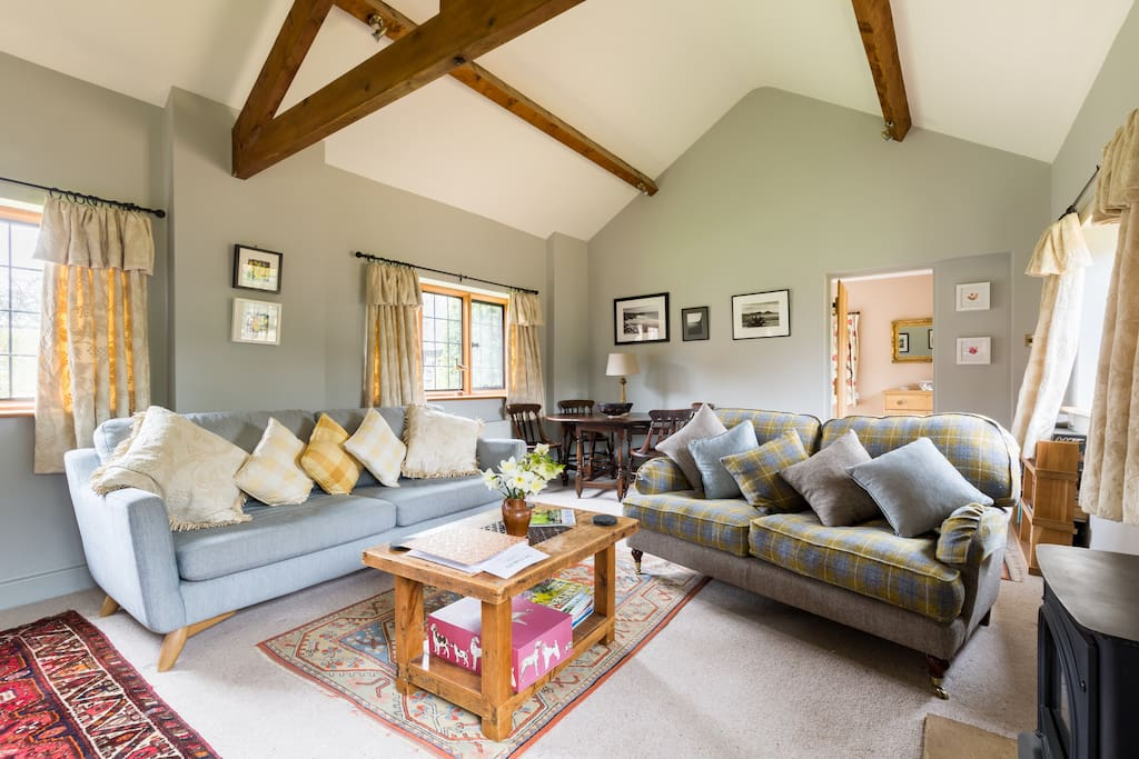 Spacious sitting room with gas effect log burner