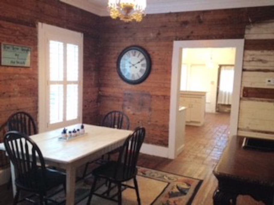 Dinning room with rustic farm table.