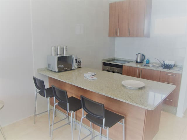 Fully equipped kitchen including full oven, hob, microwave, fridge, freezer, kettle and toaster