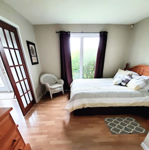 Master bedroom with sliding French doors that open 5 feet wide.
