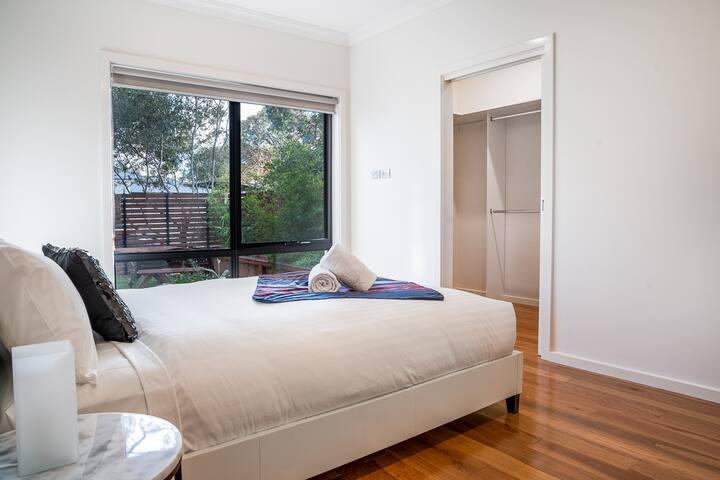 Main bedroom with comfortable queen bed...