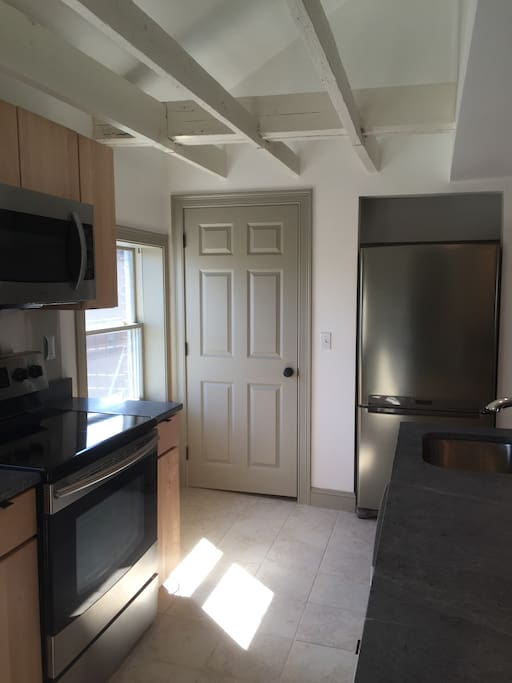 Upper: New stainless electric range, microwave, refrigerator, dishwasher.