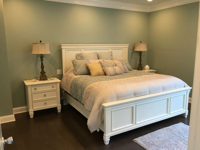 Master bedroom with king-size bed and tv.  The private master bath has a spa shower as well as a soaker tub.