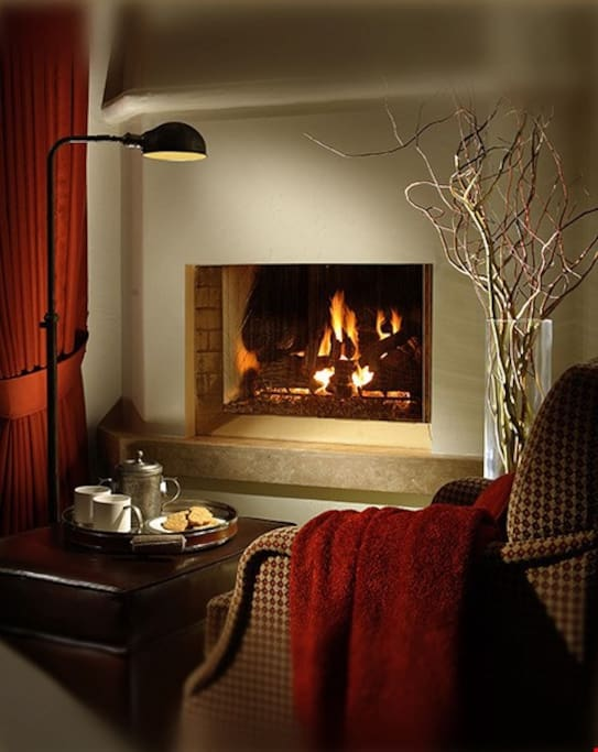 Cozy up in front of the fireplace.