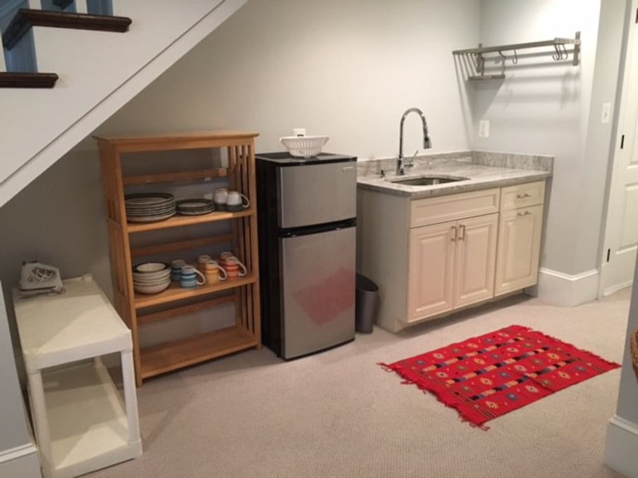 Kitchenette is stocked with dishes, pots and pans, etc.
