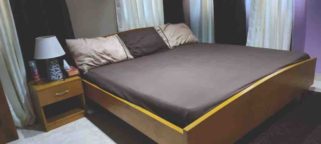 Master bedroom with - King size bed