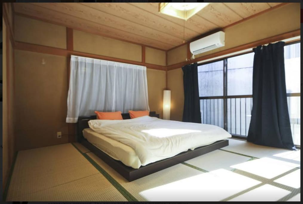 Japanese Tatami Room with 2 single beds that can be arranged into a king sized bed.