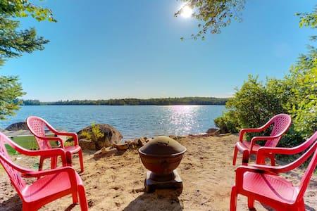 Quiet lakefront cottage w/ firepit, private beach & dog-friendly attitude