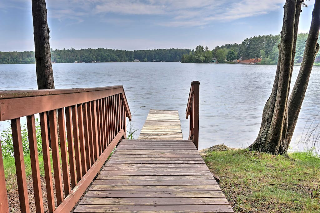 Nestled along Round Lake, this property provides a private, natural setting.