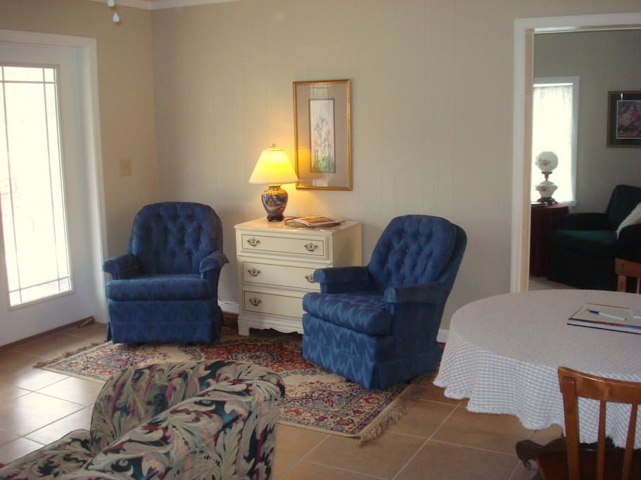 The sitting room has a sofa and four easy chairs plus a table and chairs for eating and games.