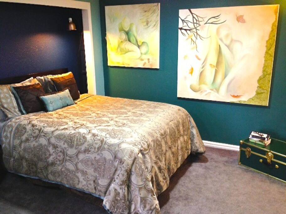 Welcome to the Kalakala Suite! A pillow-topped queen bed with local artwork welcomes you!