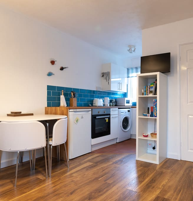Kitchen area is open plan with living area and was renovated in 2018.    Shelves have smart TV (bring your Netflix etc passwords!), DVDs, games, interesting guide books, maps, charging cables for phones and Welsh phrase book etc.