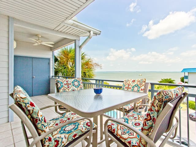 Top-floor 2 bedroom condo offering beautiful views of the bay - watch ships and dolphins and more! - Bay View Villas 302