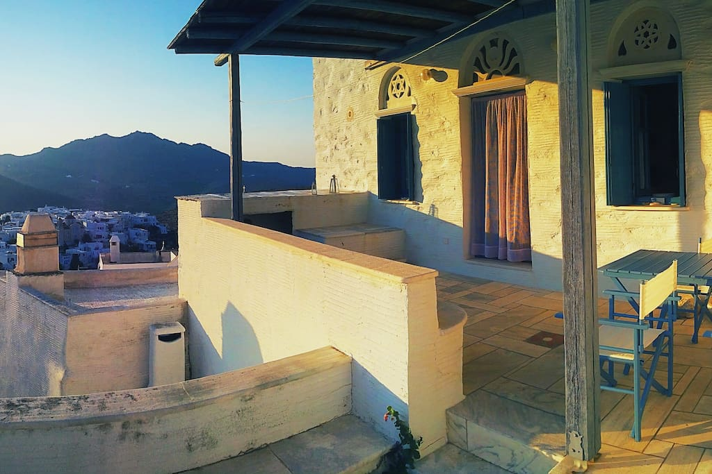 The apartment has a spacious balcony with a panoramic view to the village of Pyrgos.