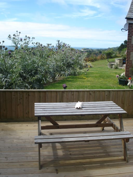 Decking with table and views over to St Catherine's point.