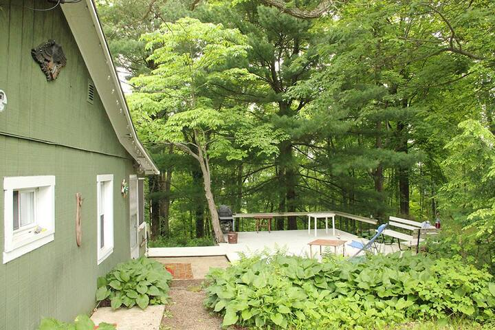 Situated on 3/4 wooded acre