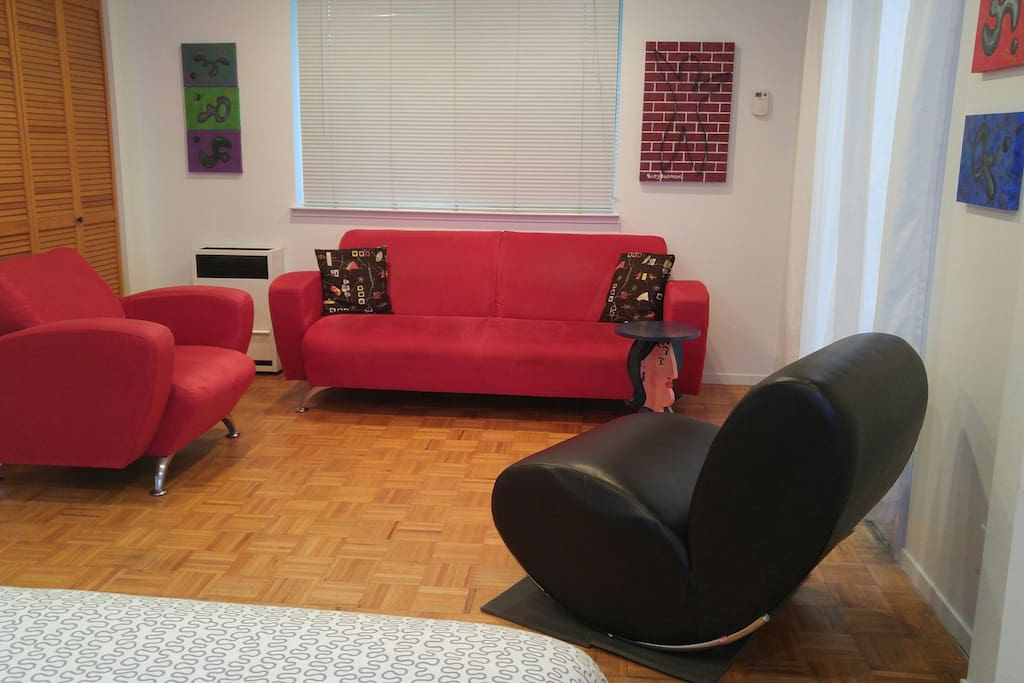 Reverse angle of room, showing couch and chairs.