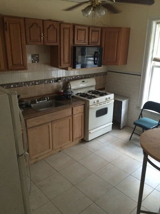 Bright, spacious eat in kitchen with stove, microwave, refrigerator