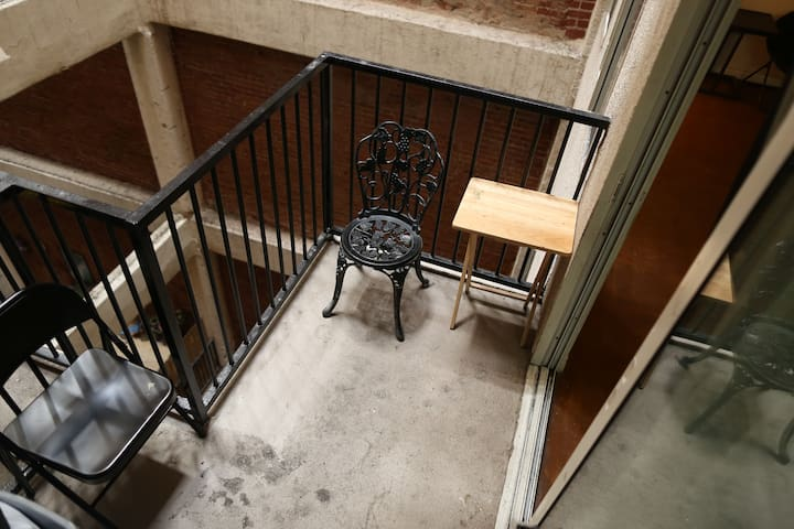Patio outside living room. 3 chairs available. Smoking allowed in entire space but preferably in living room/on patio.