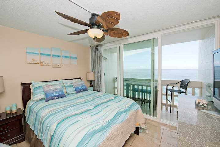 Queen size pillow top mattress - very bright with large sliding glass door looks out over ocean.