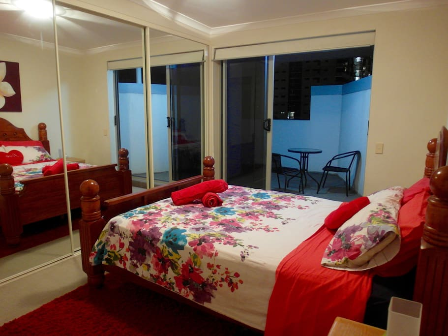 Large queen size bedroom with private balcony  on city view
