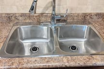 Double stainless steal sink and new faucet make meal prep and clean up a breeze!