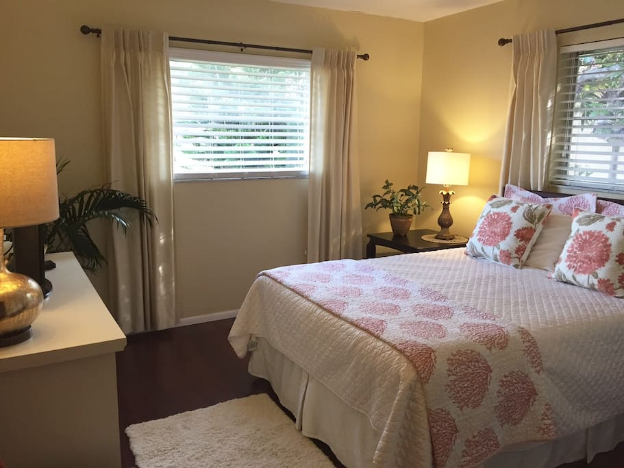 Serene, freshly painted room with beautiful linens
