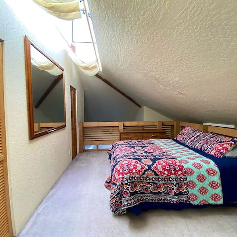 Queen bed loft room.  This room has a half bathroom. Space for a twin air mattress if traveling with little ones who want to sleep near parents.