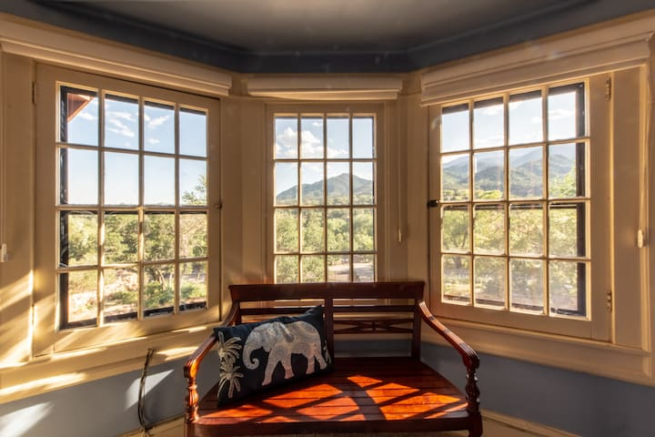 Bay window views of the Smokebrush gardens South of the building, Cheyenne Mountain and more.