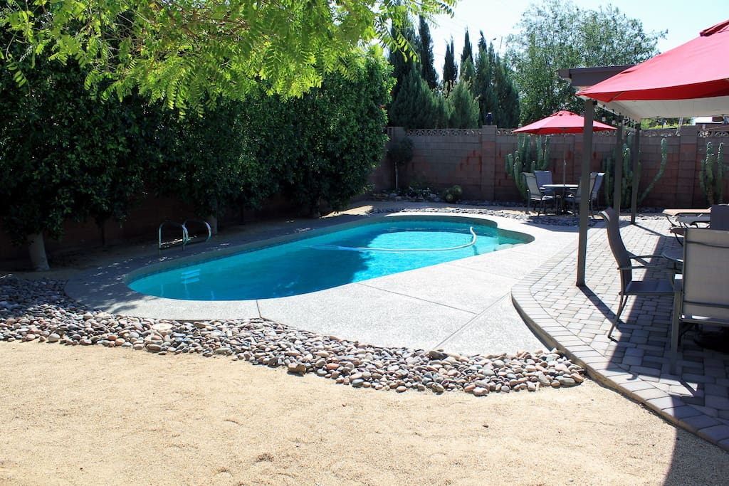 Oasis Backyard, pebble Tec pool, lounge chairs and outdoor dining,  BBQ Grill.