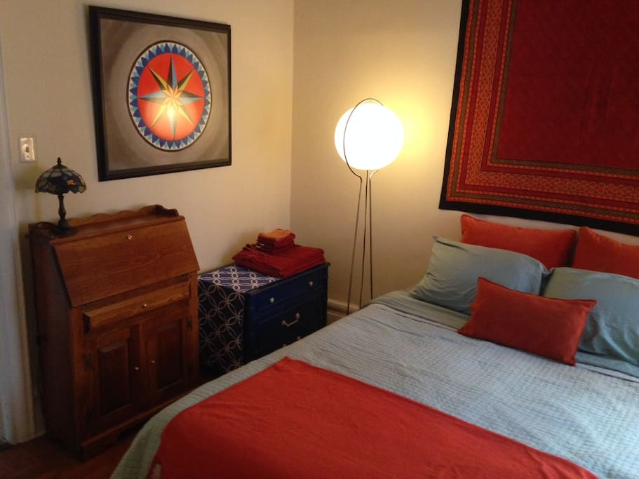 The bedroom includes a secretary (fold out desk)  and a dresser for clothing storage.
