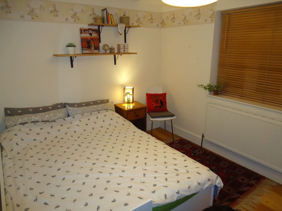 This is our guest room, with a double bed and lots of storage space