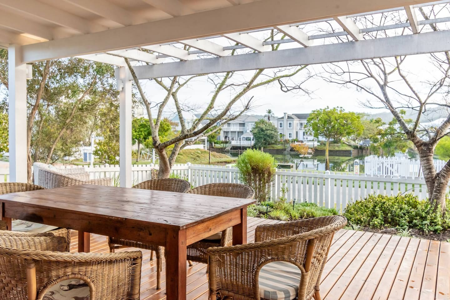 Spacious covered deck with water views and built in braai