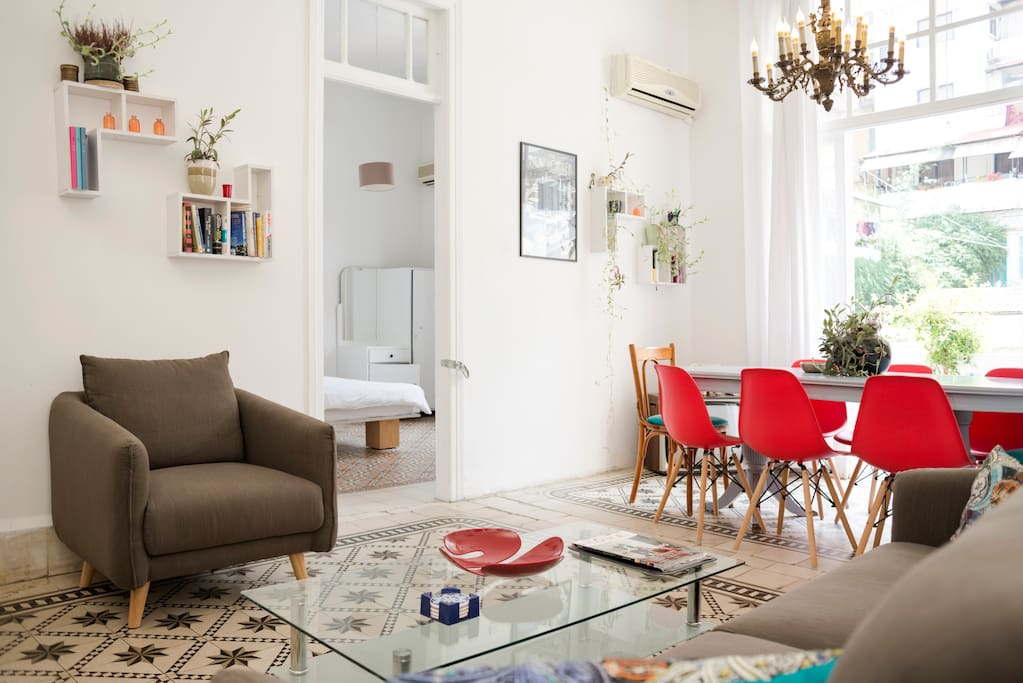 The central living area is surrounded by the apartment's five bedrooms.
