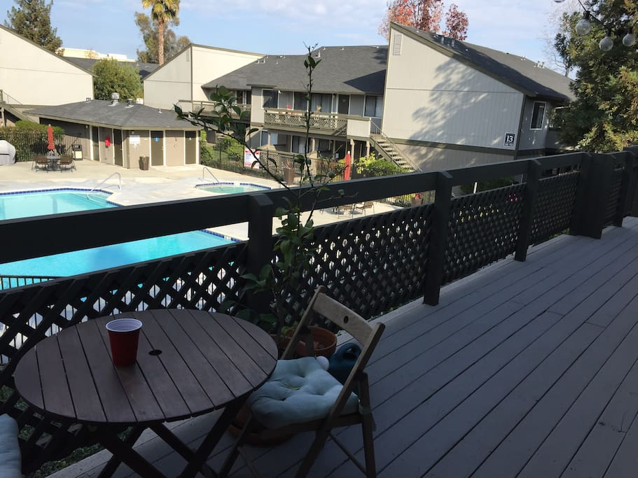 Front Deck with patio table, overlooking the Pool & Jacuzzi #1