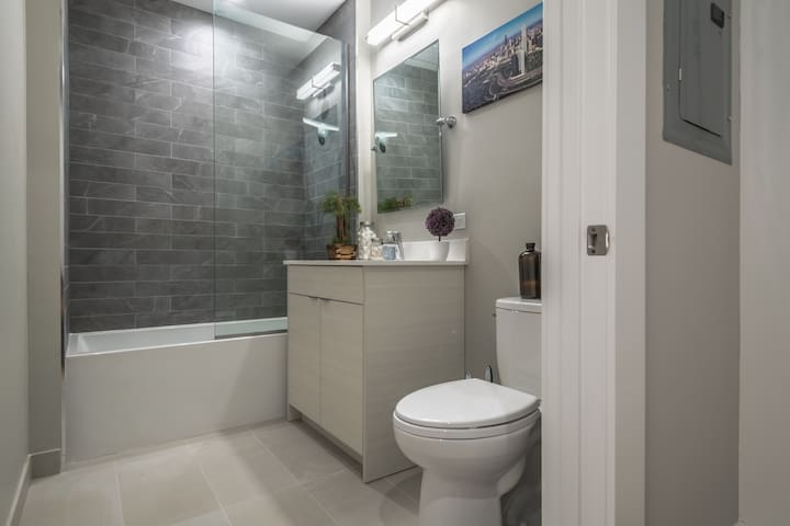 Full guest bathroom offers deep soaking tub and shower and quartz vanity! Towels, body wash, shampoo, hair dryer, hand soap, and toilet paper provided in both bathrooms!