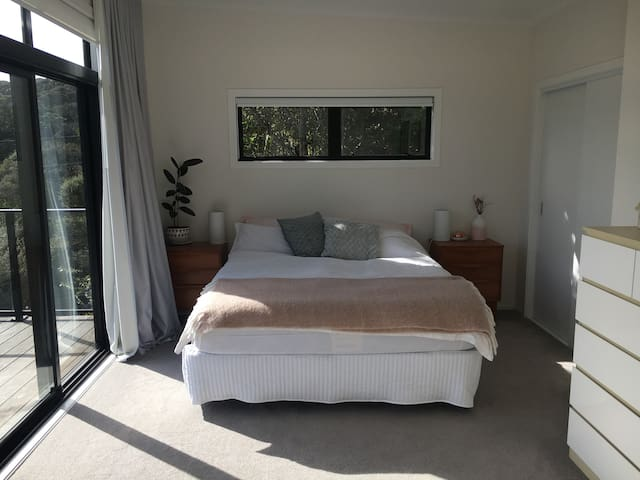 Master bedroom with bush views and leads onto front deck